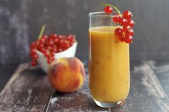 Red currant peach smoothie. Healthy red currant peach smoothie Stock Image