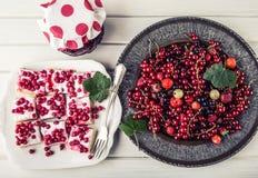 Red currant sponge cake. Plate with Assorted summer berries, raspberries, strawberries, cherries, currants, gooseberries. Fresh summer garden fruit Stock Photo