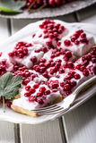 Red currant sponge cake. Plate with Assorted summer berries, raspberries, strawberries, cherries, currants, gooseberries. Stock Photography
