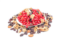 Red currant and strauberry and nuts. An fruit plate of red berries and strawberry and nuts Stock Images