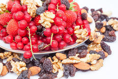 Red currant and strauberry and nuts. An fruit plate of red berries and strawberry and nuts Royalty Free Stock Images