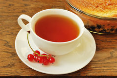 Red currant tea. Tea with red currant on wood table stock images