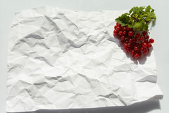Red currant on white background, healthy food, fresh fruit, crumpled paper background Royalty Free Stock Photo