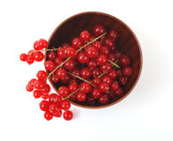 Red currant in a wooden cup on a white background Royalty Free Stock Image