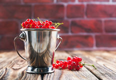 Red currant. On the wooden table,stock photo royalty free stock images