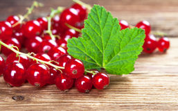 Red currants with leaf on wood Stock Photo