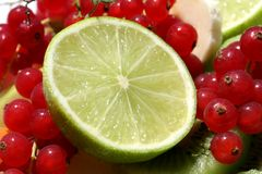 Red currants and lime Stock Photos