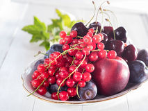 Red currants, nectarines and cherries in a bowl Royalty Free Stock Photo