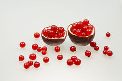 Red currants and passion fruit peels Stock Photo