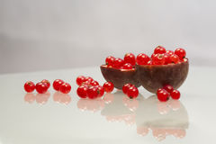 Red currants and passion fruit peels Royalty Free Stock Image