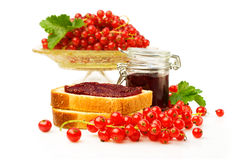 Red currants and sandwiches with jam Royalty Free Stock Image