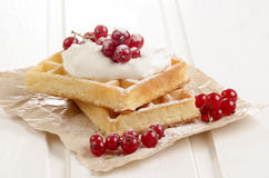 Red currants with sour cream on waffle Royalty Free Stock Photo