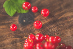Red currants on a wooden surface Royalty Free Stock Image