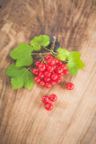 Red currants on a wooden surface Royalty Free Stock Images