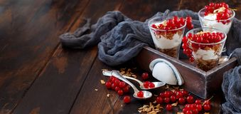 Red currants and yogurt. In a glass close up Stock Image