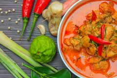 Red curry chicken, Thai Spicy food and fresh herb ingredients on wooden top view / still life, selective focus. Red curry chicken, Thai Spicy food and fresh herb stock image