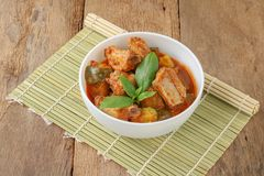 Red curry rib pork and pumkin. Red curry rib pork with pumkin on wooden table,Thai food stock images