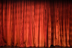 Red curtain. Red velvet Theater Curtain with irregular relief Stock Images