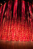 Red Curtain. A velvet red theater curtain with traces of gold Royalty Free Stock Images