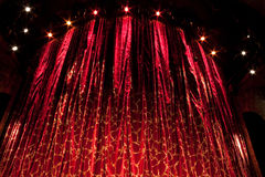 Red Curtain. A velvet red theater curtain with traces of gold Stock Photos