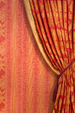Red curtain. Ornate red curtain with ornaments covering the whole window stock images