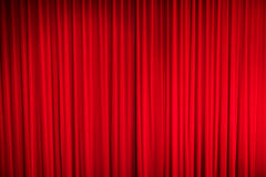 Red curtain. Red closed curtain with light spots in a theatre Royalty Free Stock Photo