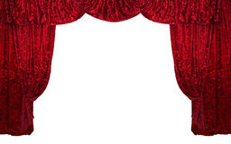 Red curtain. Red draped velvet theater curtains isolated Royalty Free Stock Photo