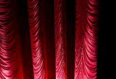 Red curtain as an abstract background. Texture Royalty Free Stock Images