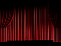 Red curtain background lit from below Stock Images