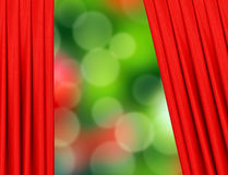 Red curtain on christmas holiday background over festive bokeh Stock Photography
