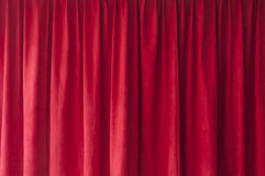 Red curtain. Closeup of closed red curtain Royalty Free Stock Photos