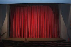 Red curtain in an empty cinema Stock Photography