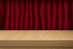Red curtain with empty wooden table Stock Photography