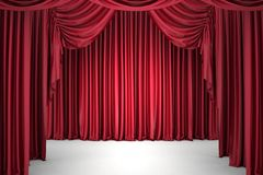 Red the curtain, lit by a spotlight Royalty Free Stock Photos