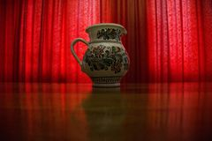 Red curtain low light art vase Stock Photo