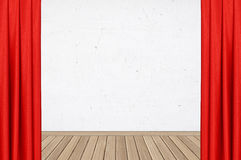 Red curtain over plaster white wall with wood parquet Royalty Free Stock Photography
