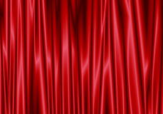 Red curtain reflect with light spot on background. Stock Images