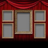 Red curtain room with wooden frames Stock Images