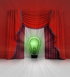 Red curtain scene with green shiny bulb and flare Royalty Free Stock Photography