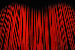 Red curtain on stage. Red curtain before the show Stock Image