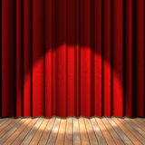 Red curtain stage with a spot light Royalty Free Stock Photo