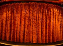 Red curtain on a stage. Red velvet stage theater curtains Royalty Free Stock Photos