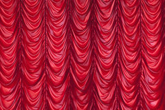 Red Curtain. Symmetrical red curtain background and wallpaper stock photo