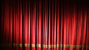 Red curtain on theater or cinema stage slightly opens.  stock video footage