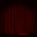 Red curtain in theater. Royalty Free Stock Photo