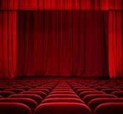 Red curtain on theater stage with red velvet seats Royalty Free Stock Photography