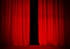 Red curtain on theatre or cinema stage. Slightly open Royalty Free Stock Photo