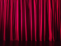 Red curtain in a theatre. Horizontal image. Stock Image