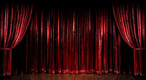 Red Curtains. Stage red curtains over wooden floor Stock Photography