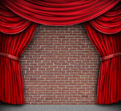 Red Curtains On A Brick Wall. Red curtains or velvet drapes on an old rustic brick wall as a theatrical stage for theater and stand up comedy performance royalty free illustration